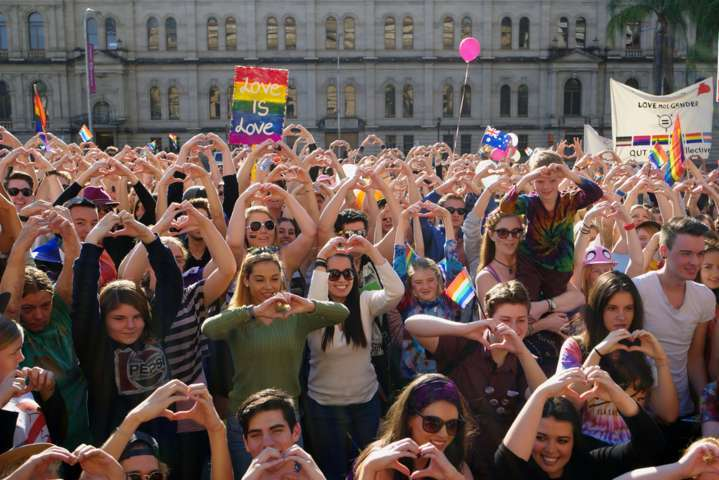 Crowds making love heart hand sign at Marriage Equality Rally